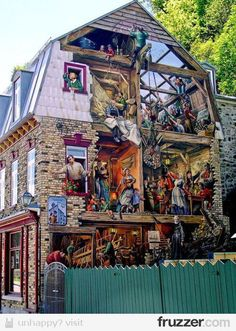 Exterior of home is painted like a mural of the interior of the house