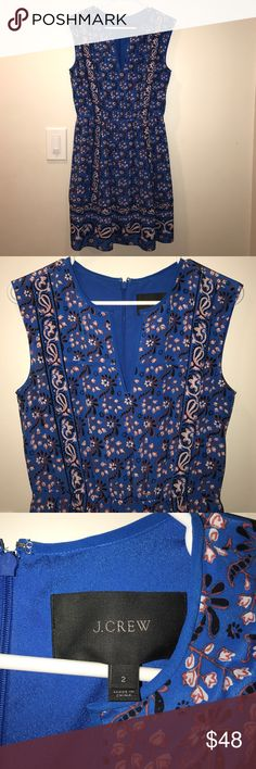 J. Crew dress Super cute and perfect for the Spring. Blue dress with Floral print. V-neck. Lined with blue fabric. Like new!!! Size 2. J. Crew Dresses