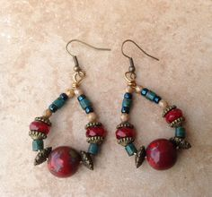 A personal favorite from my Etsy shop https://www.etsy.com/listing/272258920/beaded-hoop-earrings-in-rich-colors-of