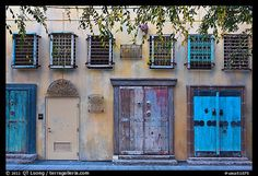 Wall with weathered doors and windows. Santana Row, San Jose, California, USA (color)