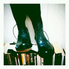 Boots over books: is this some kind of division?    Women's Madden black riding boots, zippered, all leather, 9M