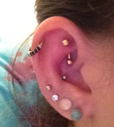 Snug and rook ear piercings. Nice, I have three I'm happy with those :)