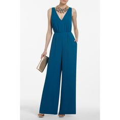 This jumpsuit is bad ass! I love the color and there is a sexy cut out in the back. I'd wear it with a belt at the waist.