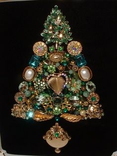 A collection of vintage jewelry makes a beautiful Christmas tree -