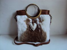 Fur/leather bag with bronze holdings and heart on front: Movleggie