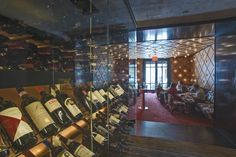 Spivak Architects - The Mark Restaurant by Jean-Georges. Wine case. Chrome flush-mounted ceiling and wall lights.