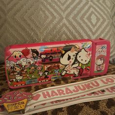 tokidoki Authentic Hello Kitty Tokidoki pencil box. Selling this for my daughter. The sharpener works. The plastics to open the sharper are spring loaded & work good. The closures are magnetic. Opens for pencils on the top & bottom idk if i missed any hidden compartments. Adorable for anyone. Who doesn't love hello kitty & tokidoki? Belt is available in another listing as well. Xoxo tokidoki Bags Mini Bags