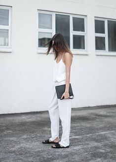 Common Projects Black Leather Slide Sandals, Alexander Wang Prisma Double Envelope Clutch Crossbody Bag In Matte Black, Camilla And Marc Zoya Minimalist Cami Top, Nicholas Foldover Slouch Pant