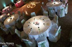 Single letter R on dance floor. Teal uplights on wall. Pin spot lighting on centerpieces.  Photo Credit- Kim Greer  #CincinnatiWedding #PartyPleasers #Singlelettermonogram #PinSpotLighting #Uplights