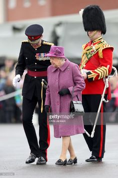 e8c8675c8a86e Queen Elizabeth II (C) attends a review and presents Leeks to The Royal  Welsh