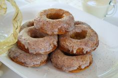 Eggnog Donuts - Easy to make, without frying, these delicious gluten free Eggnog Donuts can be made ahead of time and will delight with the flavor of the season.  Perfect for Christmas or any wintery day! Recipe uses Pamela's Baking & Pancake mix.