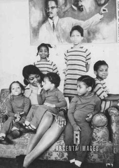 Mrs. Betty Shabazz, widow of the black leader Malcolm X,  with their children