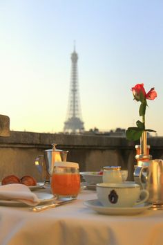 early outdoor breakfast, with a view of the Eiffel Tower... so romantic!