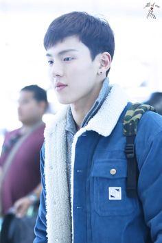 Shownu looking cute in that denim Sherpa jacket