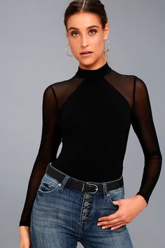 The Entrancing Black Mesh Long Sleeve Bodysuit will have them under your spell! Lightweight stretch knit forms a mock neck atop an angular neckline and fitted bodice, while sheer mesh creates a cool contrast across the shoulders, long sleeves, and low-dipping back. Attached thong bottoms with two snap closures.
