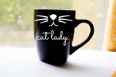 Cute coffee mug with cat whiskers and the wording cat lady. Please choose mug color from the dropdown box. The black and white mugs slightly