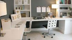 White Surfaces and Wall-Hanging Clipboards: A Creative and Clean Workspace