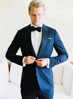 Stylish groom in navy blue: http://www.stylemepretty.com/2016/04/04/see-how-modern-chic-a-cabo-san-lucas-wedding-can-be/   Photography: Ashley Bosnick - http://www.ashleybosnick.com/