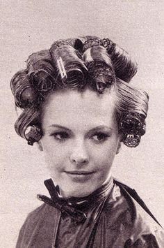 Beautiful lady in rollers-- we just don't dedicate ourselves to styling the way they used to
