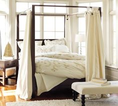 Farmhouse Canopy Bed | Pottery Barn  this look. not this actual bed.  i would never in a million years spend 1700 dollars on a bed for myself! sheesh!