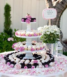 Pink three-tiered wedding cupcake tower!