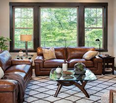 A Minnesota Casual Family Room. Warm and cozy family room with 2 leather sofas. This Minnesota Casual family room is approachable and oh-so-comfortable, but definitely not lacking in style. Family Room Decorating, Family Room Design, Brown Leather Furniture, Brown Leather Couches, Leather Living Room Furniture, Brown Sofa, Grey And Brown Living Room, Brown Leather Couch Living Room, Casual Family Rooms