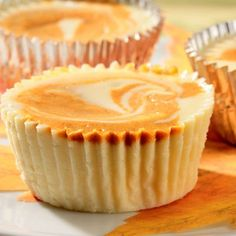 Individual Swirled Pumpkin Cheesecakes: Pamper guests this holiday season with individual delights. An elegant fusion of two fall favorites, pumpkin pie and gingerbread, makes these mini cheesecakes irresistible. [Sponsored by Nestle Coffee-Mate] Mini Desserts, Just Desserts, Delicious Desserts, Dessert Recipes, Cupcake Recipes, Cookbook Recipes, Sweet Pumpkin Recipes, Pumpkin Swirl Cheesecake, Cheesecake Cups