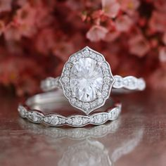 Forever One Moissanite Engagement Ring and Scalloped Diamond Wedding in 14k White Gold Vintage Floral Bridal Set 8x6mm Oval Cut Gem Ring Set by LaMoreDesign on Etsy https://www.etsy.com/listing/271563597/forever-one-moissanite-engagement-ring