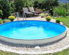 31 our new stock tank swimming pool in our sloped yard 00026