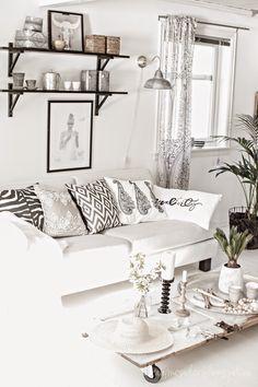 white scandinaving living room. like the pillows a lot