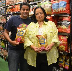 Mihir Shah, founder of Cobra Corn, is pictured with his mother, Dr. Teju Shah (inventor of Cobra Corn) at the first Whole Foods Market in Chicago to carry the product.