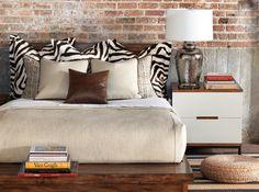 Zebra pillows, mid-century nightstand. #bedroom #design