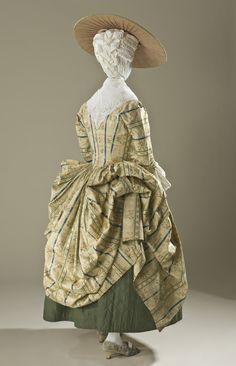 Back view, robe à la Polonaise, France, c. 1775. Brocaded ivory silk with blue and green stripes and flower sprays.