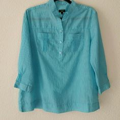 """SALE* Talbots Blue Tunic Top Cotton blouse with mandarin collar, three button placket, pleats on pockets, 3\4 sleeves with pleats near buttoned cuffs. Pleats also below back yoke. Notched side seams.  Too big for me, was washed but not worn.  Bust  44"""", shoulders 17"""", length from back of neck 26"""". Talbots Tops Tunics"""