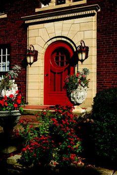 Lighting is by Capitol Lighting/red front door/red screen door/rounded front door