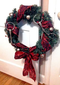 This equestrian themed holiday wreath will catch the eye of all your guests this Christmas season. The wreath features red berries, ornaments, two horse bits, and ribbon (ribbon colors may vary). Other ribbon colors may be added upon request. Allow a week for the wreath to be made. This would be a great present for the equestrian enthusiasts in your life!   $65
