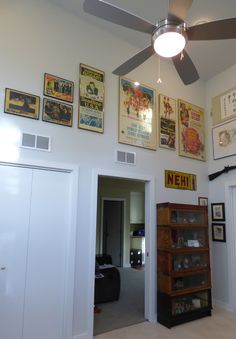 """""""Gallery Wall"""" arrangements apparently are a thing - and here I just thought I was hanging pictures. East wall in my Man Cloud: Original movie posters featuring Marilyn Monroe, Humphrey Bogart, Gene Kelly, Marx Brothers, Fred Astaire and Godzilla. Tin NEHI sign from 1938."""