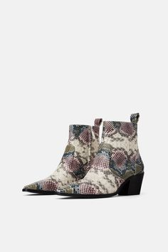 fbbd18cd7a1 Animal print cowboy heeled ankle boots
