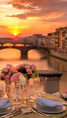 A romantic dinner at the Four Seasons Hotel Firenze on Ponte Vecchio overlooking the Arno River in Florence, capital of Italy's Tuscany region