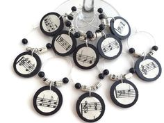 Music Themed Party Decoration, Music Wine Charms, Wine Charms With Sheet Music Paper Beads, Music Wine Glass Charms, Music Party, Music Gift by AtHomeWithWords on Etsy https://www.etsy.com/listing/458194062/music-themed-party-decoration-music-wine