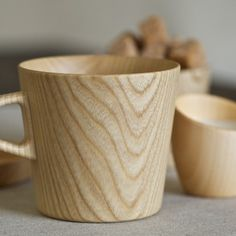 ....GOTTEN....  Kami Wood Mug - Designed by Oji Masanori and handcrafted at the Takahashi Kougei wood workshop in Hokkaido. The Kami mug is made of castor aralia wood from Hokkaido, shaped down to a thickness of 2 mm, which allows light to glow through but remains thick enough for durable insulation.  Made in Japan of castor aralia.  Finished with food-grade polyurethane.  Approx. 9 oz. capacity.