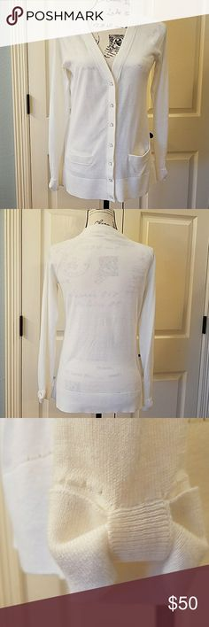 Kate Spade Cary Cardigan EUC Pretty and soft, light-weight cardigan.  Color is off-white.  Buttons down front.  Has two front pockets.  Has bows on cuffs.  Only worn once.  No flaws. kate spade Sweaters Cardigans