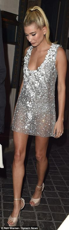 Sheer delight: Meanwhile, model pal Hailey worked a daring sheer silver mini dress for the glamorous dinner