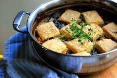 Collard cobbler with cornmeal biscuits. Veganize w/ almond milk and earth balance or cashew cream subbed for the cream