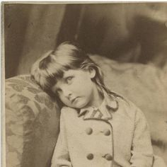 Xie Kitchin sitting in sofa corner :: Lewis Carroll (Charles Lutwidge Dodgson) Photography Collection