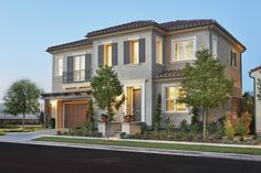 This two-story Paris home in Irvine, CA, features a sleek stucco exterior and an elegant Spanish-tile roof. Other noteworthy features of this exquisite Richmond American plan include stylish shutters and a second-floor balcony.