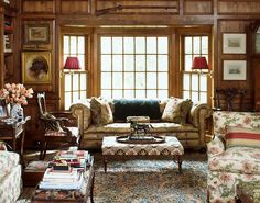 plethora of patterns in this English wood-panelled library with leather sofa