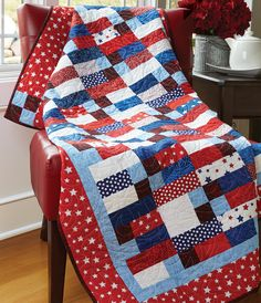 CHECK IT OUT by Susan Emerson: Designer Susan Emerson designed a simple block and hopscotched it with its mirror image in this easy-to-sew throw. Featured fabric collection: Yankee Doodle Essential Gems collection by Wilmington Prints.