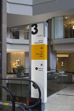 Hyatt Regency Hotel, New Orleans Wayfinding System - Graphis Standing Signage, Tokyo Midtown, Regency Hotel, Office Signage, Wayfinding Signs, Outdoor Signage, Clinic Design, Signage Design, Parking Design