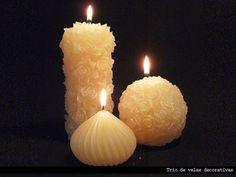 Trio de velas decorativas <br>Modelo exclusivo! <br>Cores e essência a sua escolha <br> <br>Peso Total : 750 gramas <br> <br>Cilindro : 15x7 cm <br>gota: 7,5 x 5,5 gramas <br>Esfera: 8,5 cm